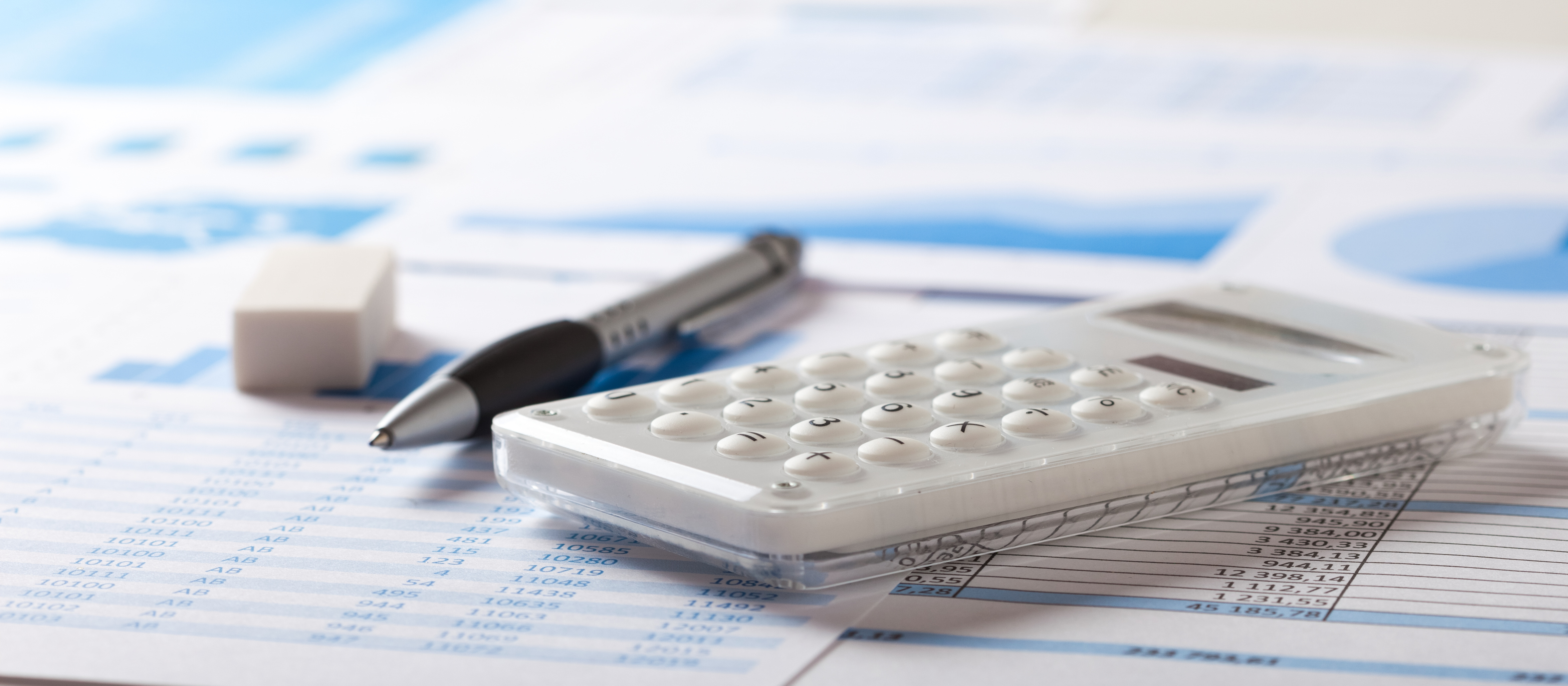 Accounting concept: pen, calculator and paperwork