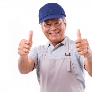 smiling happy worker giving two thumbs up hand gesture